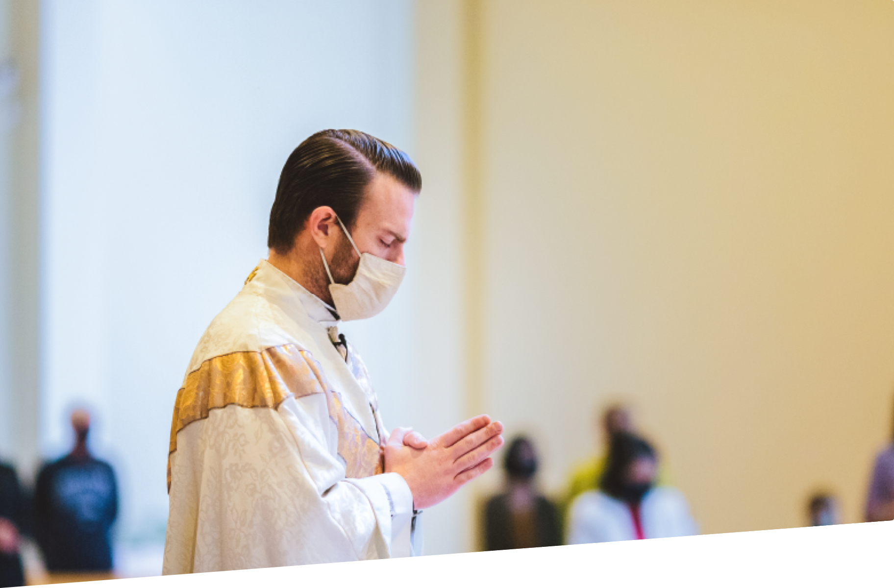 Father Colin at a Mass